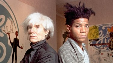 Andy Warhol (left) with Jean-Michel Basquiat in 1985.