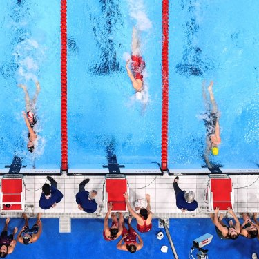 Cate Campbell touches the wall just before Abbey Weitzeil in the women's 4x100m medley relay.
