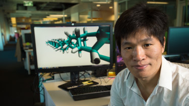 QUT's Dr Haifei Zhan with a molecular model of the diamond nanothread.