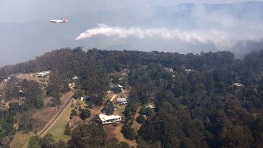 QFES Large Air Tanker dropping 15,000 litres of water over bushfires in Binna Burra in the Scenic Rim region.