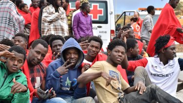 Migrants from Africa stormed a border fence to enter Spain's North African enclave of Ceuta from Morocco in December.