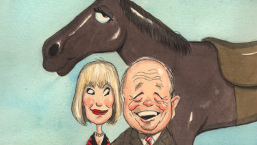 Horse racing enthusiasts Gerry Harvey and wife Katie Page.