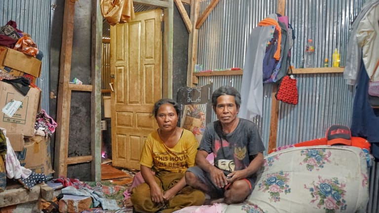 Lombok refugees Ismail, right, and his wife Suhaini  in their temporary home.