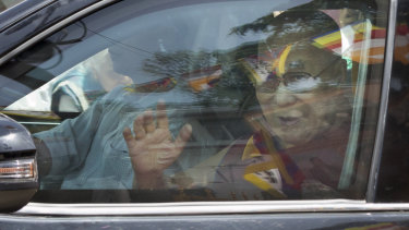 Tibetan spiritual leader the Dalai Lama greets devotees as he arrives in Dharmsala after a hospital stay.