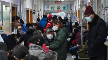 Patients crowding into a Red Cross hospital in Wuhan.