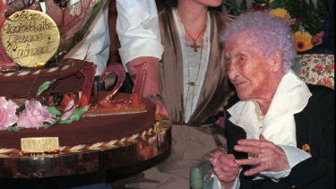 Jeanne Calment looks at her birthday cake as she celebrates her 121th birthday at her retirement home in Arles.