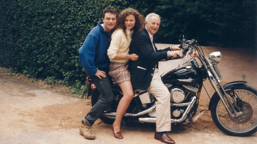 On leave: McBride on a Harley Davidson he'd just bought, with his father William and sister Catherine.