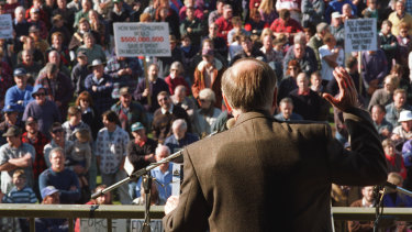 John Howard wears a bullet-proof vest at a rally in Sale in June 1996 to argue for gun restrictions. The national registry that was promised at the time has never eventuated.