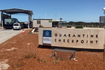 A truck driver who crossed into Western Australia through Eucla has been charged with breaching emergency laws.