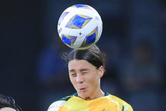 Sam Kerr of the Matildas contests a header with Zhang Xin of China in their Olympic qualifier earlier this month.