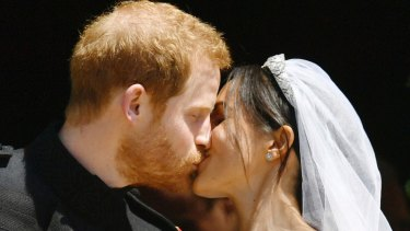 Prince Harry and Meghan Markle kiss on the steps of St George's Chapel in Windsor Castle after their wedding in Windsor