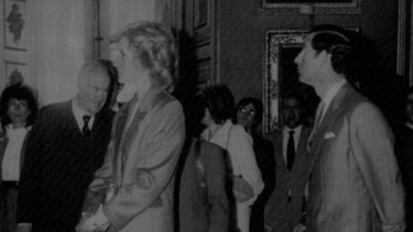 Sir Harold Acton with Princess Diana and Prince Charles as they admire art inside Pitti Palace in 1985.