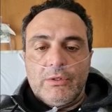 Neti Ajro speaking from his hospital bed