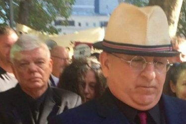 Extremist and online troll Nathan Sykes (in front) and chairman of the Australia First party, Jim Saleam (behind) attending Melbourne Magistrates Court in March, 2017, to support Christopher Shortis, who faced charges over a mock beheading.