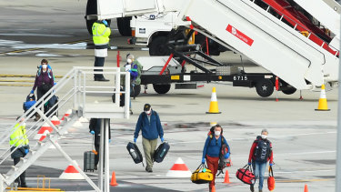 Passengers from the cruise ship MV Greg Mortimer arrive at Melbourne Airport from Uruguay.