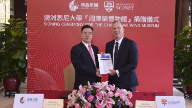 Chau Chak Wing and vice-chancellor of the University of Sydney Dr Michael Spence in Guangdong, China, shaking hands on the gift to build the Chau Chak Wing Museum.