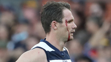 A bloodied Patrick Dangerfield comes off during the clash with Adelaide.