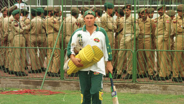 Watchful eye: Shane Warne of Australia steps on to the pitch as Pakistan police look on during Australia nets session prior to the 1996 World Cup Final between Australia and Sri Lanka played in Lahore, Pakistan.