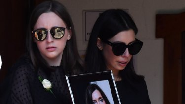 Sarah Ristevski (left) at the funeral service for her mother, Karen, in Essendon on March 6, 2017.