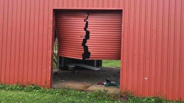 Tropical Cyclone Trevor tore this roller door in Lockhart River.