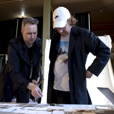 Toni Maticevski (left) and stylist Jolyon Mason look over the running order for the show.