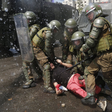 Police subdue a protester on October 20 in Santiago.