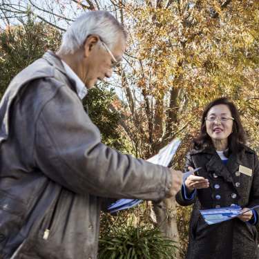 Gladys Liu greets a voter on election day in 2019, having worked polling stations assiduously for weeks.