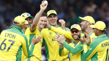 Australia's Jason Behrendorff, centre, celebrates after taking the wicket of England's Jofra Archer.
