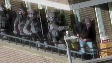Armed police prepare for an operation in a residential area in Arnhem, Netherlands.