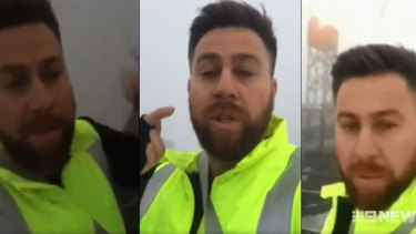 The 33-year-old man was charged after he climbed the top of the Harbour Bridge in protest at Iran.
