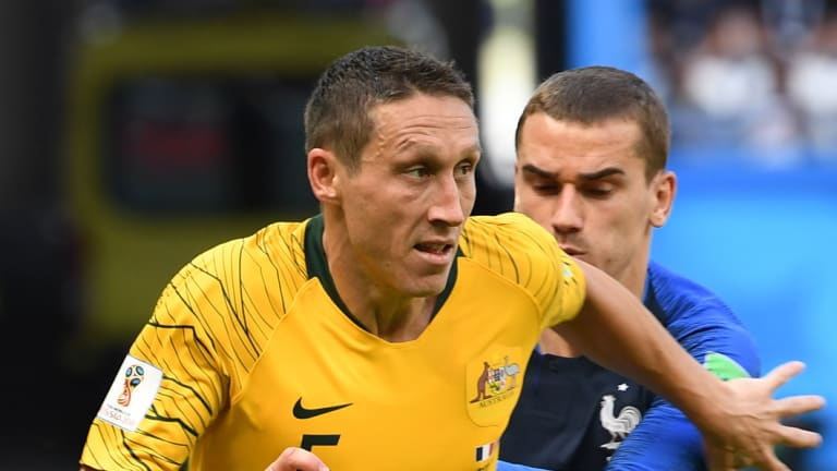 Staying on: Mark Milligan will remain with Australia through to the 2019 Asian Cup at least.