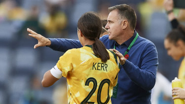 Coach Ante Milicic and Sam Kerr confer on the sidelines.