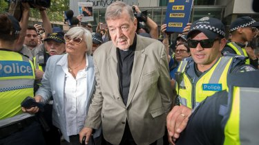 Cardinal George Pell pictured leaving the County Court where was found guilty of historical sexual offences.