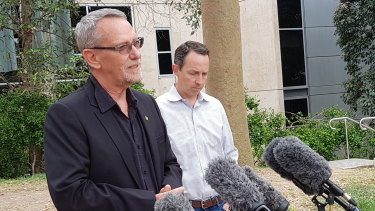 UQ scientists Professor Paul Young and Professor Trent Munro explain to the media why their vaccine program is being halted.