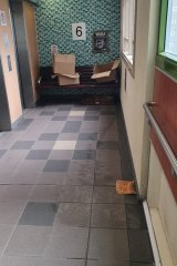 Food left outside a lift at Melrose Street, North Melbourne, on Monday.