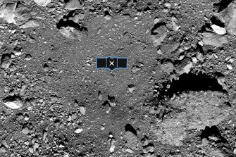 "The OSIRIS-REx spacecraft's primary sample collection site, named ""Nightingale,"" on the asteroid Bennu. An outline of the OSIRIS-REx spacecraft is placed at center to illustrate the scale of the site."