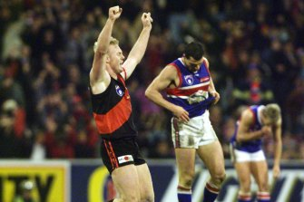 Essendon's Paul Barnard jubilant and exhausted as the siren goes.