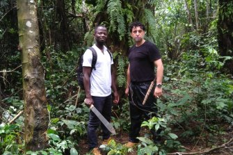 Olivier Lokolomba (left) and Joseph Bagala in the forest near Bokuma in northern Congo.