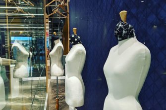The mannequins at the front of the shop.