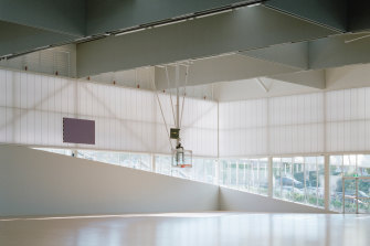 The centre features a parasol-style canopy covered in a high-tech fabric, translucent polycarbonate walls and glass.