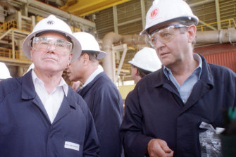 Prime Minister John Howard (left) is shown around the expanded Olympic Dam mine in South Australia by Western Mining's Hugh Morgan in 1999. Morgan had begun his campaigns to influence politicians in the 1970s.