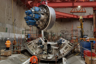 One of two huge tunnel boring machines is lowered into place for assembly in the Metro Tunnel underground works area in North Melbourne. Two tunnel boring machines will dig the entire 9-kilometre twin tunnels.