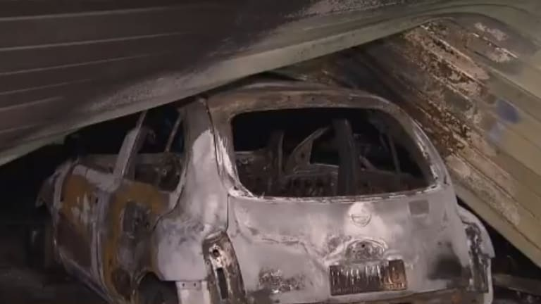 A stolen car was allegedly rammed into a south-west Brisbane business, before being set alight.