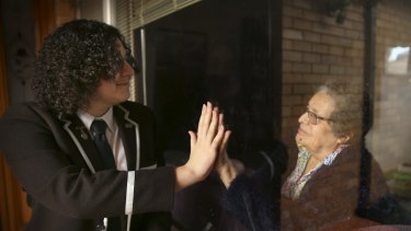 Reaching out during isolation: Sydney Boys High School student William Winter with his elderly grandmother at their Georges Hall family home.