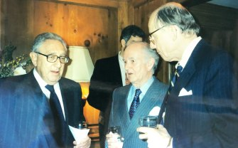 Henry Kissinger, Owen Harries and Harvard political scientist Samuel Huntington at the National Interest editorial board drinks in 1998.