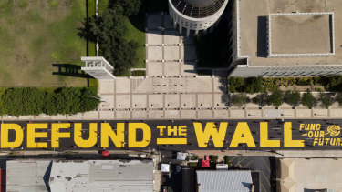 """An aerial shot of a new """"Defund The Wall"""" mural that was painted outside the Laredo federal courthouse."""