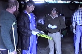 Francis Wark accompanying police during a search of his home in August 1999.