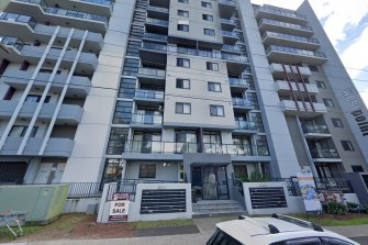 A Liverpool apartment complex is under police guard after 14 people tested positive to COVID-19