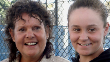 Ashleigh Barty, then the winner of the Wimbledon girls' singles title, with her idol and tennis great Evonne Goolagong Cawley in 2011.