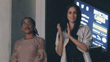 Meghan Markle, right, watches the closing ceremony of the Invictus Games with her mother  Ragland in Toronto, Canada, last year.